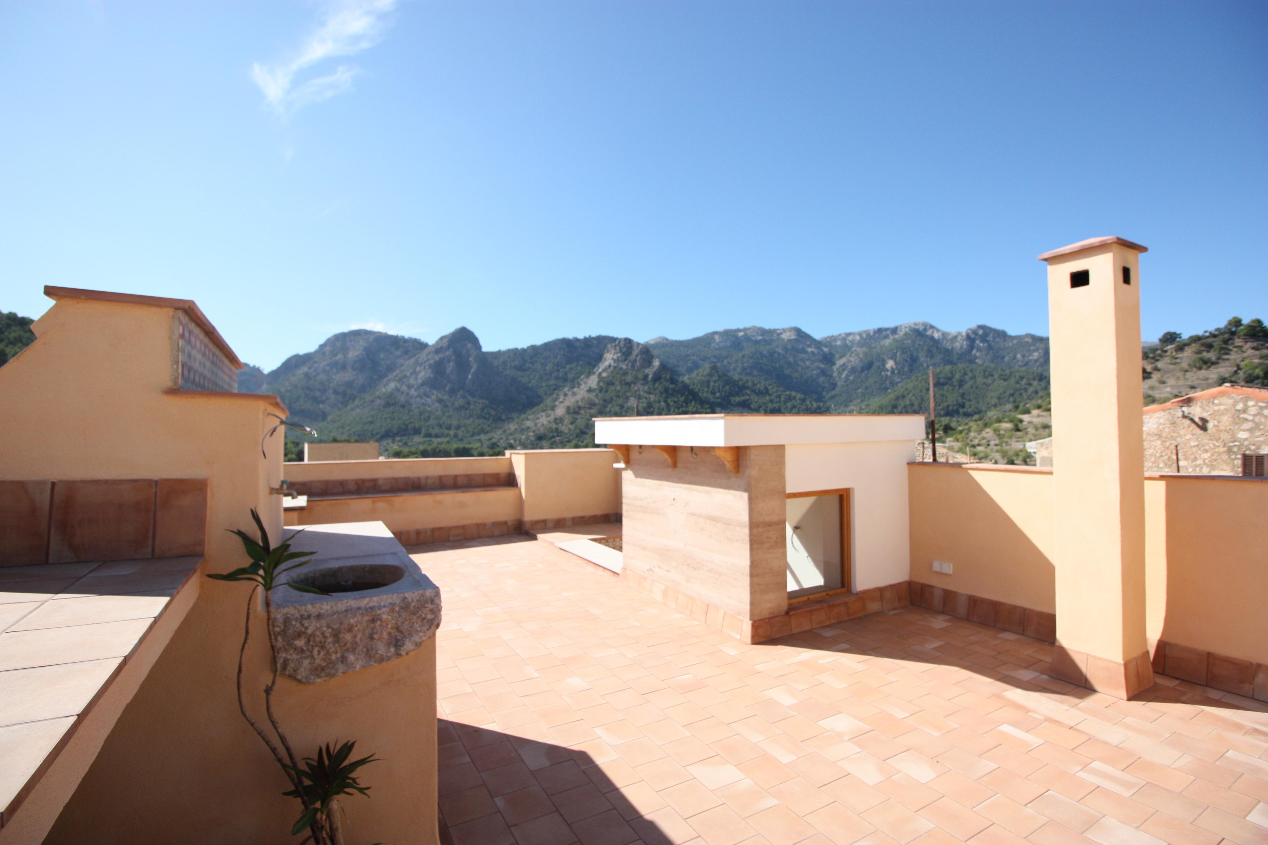 Ático con magnificas vistas sobre el pueblo de Buñola